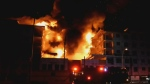 Huge fire destroys condos under construction