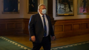 Ontario Premier Doug Ford walks to his office at the Queens Park Legislature in Toronto on Wednesday, April 7, 2021. THE CANADIAN PRESS/Chris Young