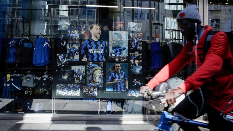 A biker rides past an Inter Milan merchandise store in Milan, Italy, on April 19, 2021. (Luca Bruno / AP)