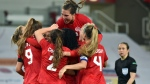 Canada players celebrate their second goal against England during the women's international friendly soccer match between England and Canada at Bet365 stadium in Stoke on Trent, England, Tuesday, April 13, 2021. (AP Photo/Rui Vieira)