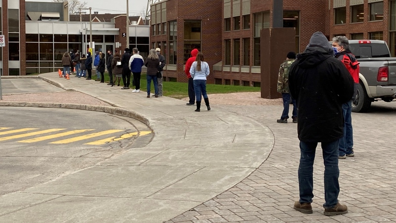 People line up outside the Dollard-des-Ormeaux Civic Centre on Wednesday, April 21, 2021 as Quebec lowers the minimum vaccination age to 45. (Kelly Grieg, CTV News)
