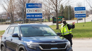 OPP check travellers entering Ontario from Quebec in Hawkesbury, Ont. on Monday, April 19, 2021. THE CANADIAN PRESS/Ryan Remiorz