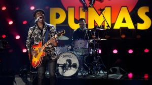 """Eric Burton of Black Pumas performs """"Colors"""" at the 63rd Grammy Awards at the Los Angeles Convention Center, in this Thursday, March 11, 2021, file photo. Grammy Award nominated rock & soul duo Black Pumas and Cleveland's own Machine Gun Kelly will perform at next week's NFL draft.  (AP Photo/Chris Pizzello, File)"""