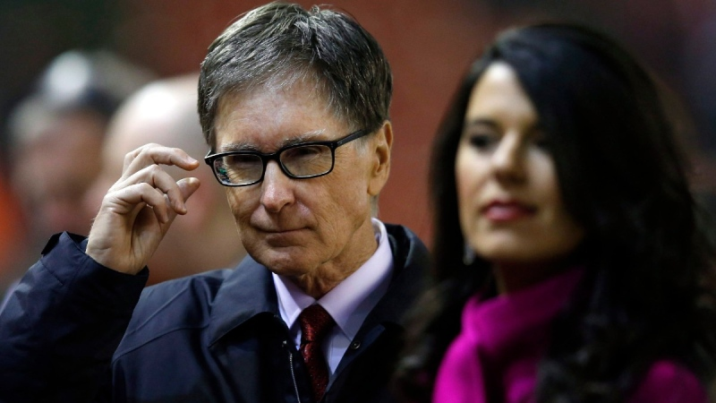 Liverpool owner John Henry and his wife Linda Pizzuti arrive at Anfield Stadium, Liverpool, England, on Feb. 10, 2015. (Jon Super / AP)