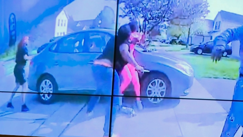 In an image from police bodycam video that the Columbus Police Department played during a news conference Tuesday night, April 20, 2021, a teenage girl, foreground, appears to wield a knife during an altercation before being shot by a police officer in Columbus, Ohio, on April 20, 2021. (Columbus Police Department via WSYX-TV via AP)