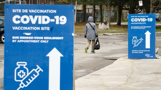 A person walks towards a COVID-19 vaccination clinic in Montreal, Tuesday, April 20, 2021. THE CANADIAN PRESS/Paul Chiasson