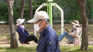 Women wearing face masks as a precaution against the coronavirus exercise at a park in Goyang, South Korea, Tuesday, April 20, 2021. (AP Photo/Ahn Young-joon)