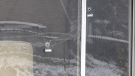 Bullet holes are visible in the side of a residence in London, Ont. on Wednesday, April 21, 2021. (Jim Knight / CTV News)