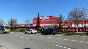 Police tape blocks off the Langley Sportsplex in Langley, B.C., on Wednesday, April 21, 2021. (Jordan Jiang / CTV News Vancouver)
