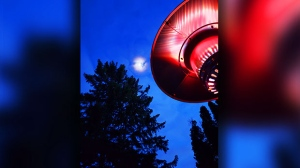 Looking at the moon and enjoying the patio heater. Photo by Paula Kenworthy.