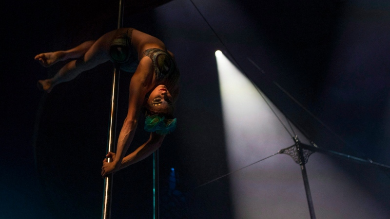 A performer is pictured on stage during a dress rehearsal for the Toronto opening of Cirque Du Soleil's latest creation 'Luzia'. Luzia is one of the shows that will relaunch after Cirque shut down due to the COVID-19 pandemic. THE CANADIAN PRESS/Chris Young.