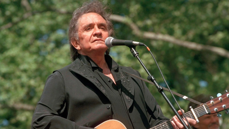 In this May 23, 1993 file photo, country legend Johnny Cash performs at a benefit concert at Central Park in New York. (AP Photo/Joe Tabacca, File)