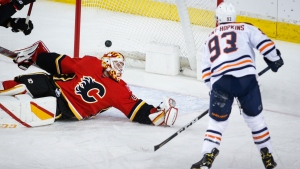 Edmonton Oilers' Ryan Nugent-Hopkins, right, scores on Calgary Flames goalie Jacob Markstrom during first period NHL hockey action in Calgary, Wednesday, March 17, 2021.THE CANADIAN PRESS/Jeff McIntosh