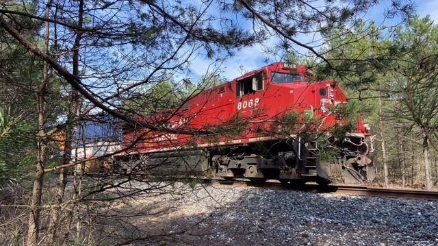 A Canadian Pacific train travels along train tracks in Midhurst, Ont. on Sat. April 17, 2021 (CTV News Barrie)
