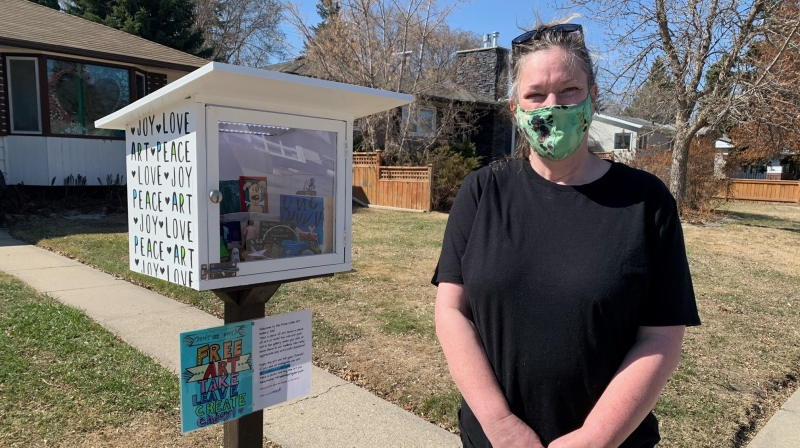 Suzy Schwanke has set up a free little art gallery in Saskatoon's Queen Elizabeth neighbourhood as a way for people to enjoy art during the COVID-19 pandemic. (Nicole Di Donato/CTV Saskatoon)