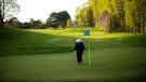 Arvo Reiart putts on a green at Daytona Park Golf course in Toronto as golf courses reopen for the first time during the COVID-19 pandemic, on Saturday May 16, 2020. THE CANADIAN PRESS/Chris Young