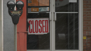 A 'closed' sign sits in the entryway of a business in downtown Stratford on Wednesday, April 21, 2021. (Ricardo Veneza/CTV News)