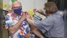 Dr. Robert Strang gets his first dose of COVID-19 vaccine at the Halifax Forum clinic on Wednesday, while he wore a Montreal Canadiens-themed Hawaiian shirt. (Photo: Nova Scotia Government)