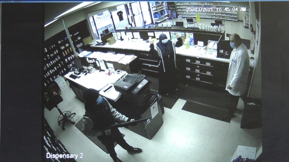 Surveillance video shows two pharmacy employees held at gunpoint at Saddleback Pharmacy in southwest Edmonton. (Source: Saddleback Pharmacy)