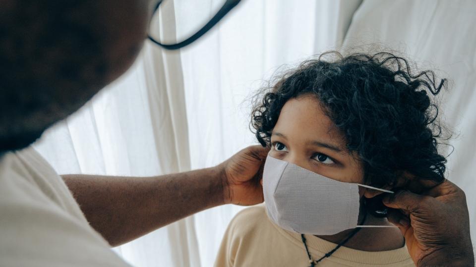 A child wearing a mask