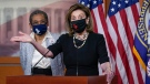 House Speaker Nancy Pelosi, D-Calif., joins Del. Eleanor Holmes-Norton, D-D.C., left, at a news conference ahead of the House vote on H.R. 51, the Washington, DC Admission Act, on Capitol Hill in Washington, Wednesday, April 21, 2021. (AP Photo/J. Scott Applewhite)