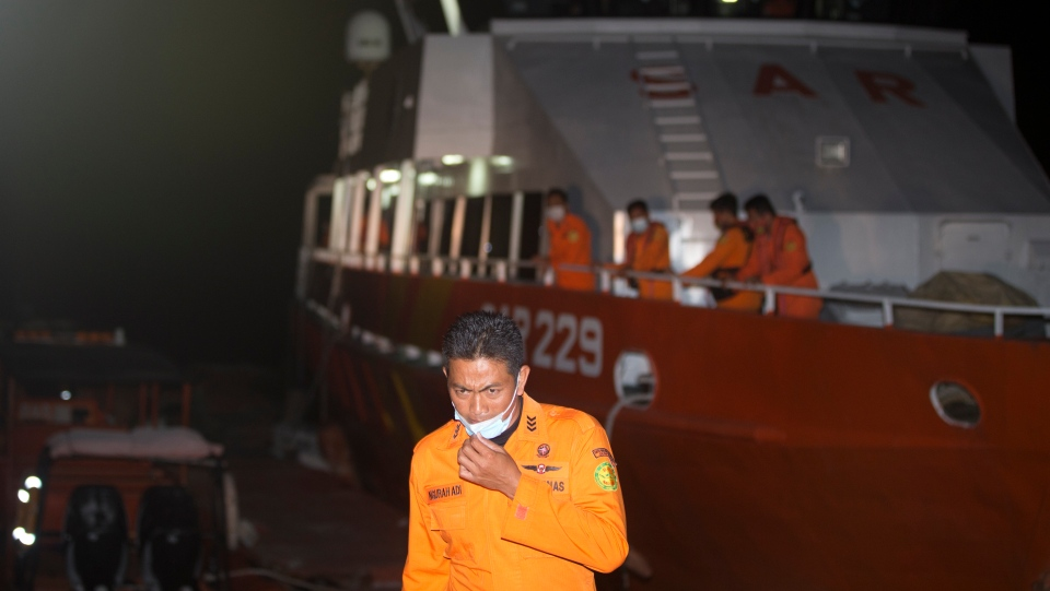 A member of National Search and Rescue Agency (BASARNAS) prepare for a search mission for The Indonesian Navy submarine KRI Nanggala at Benoa harbor in Bali, Indonesia, on Wednesday, April 21, 2021. AP Photo/Firdia Lisnawati)