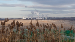 Smoke rises from chimneys of the Turow power plant located by the Turow lignite coal mine near the town of Bogatynia, Poland, Tuesday, Nov. 19, 2019. (AP Photo/Petr David Josek)