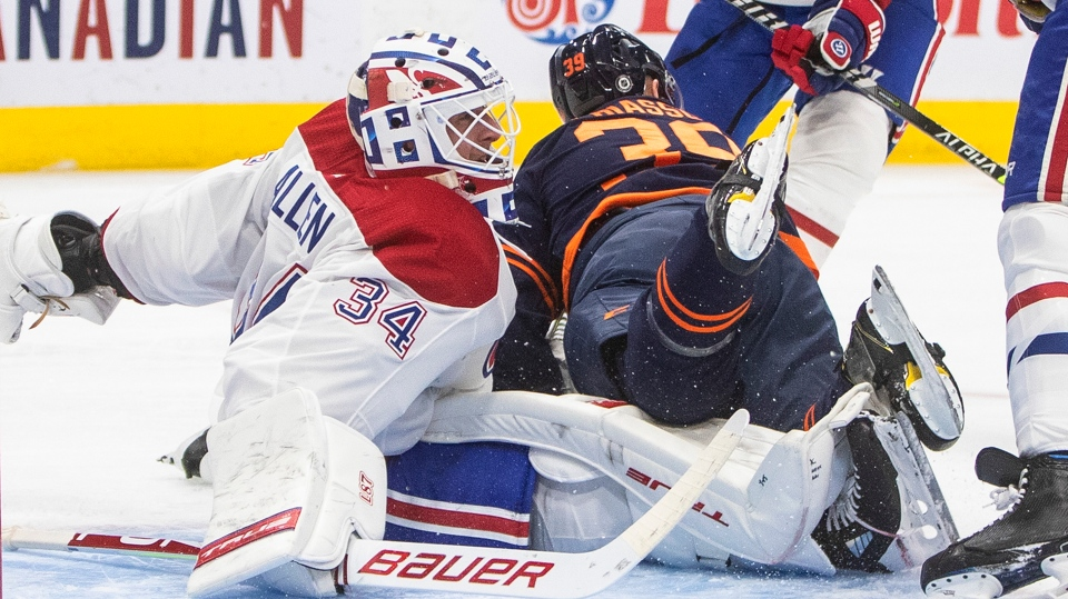 Edmonton Oilers' Alex Chiasson (39) crashes into Montreal Canadiens' goalie Jake Allen (34) during second period NHL action in Edmonton on Wednesday, April 21, 2021.THE CANADIAN PRESS/Jason Franson