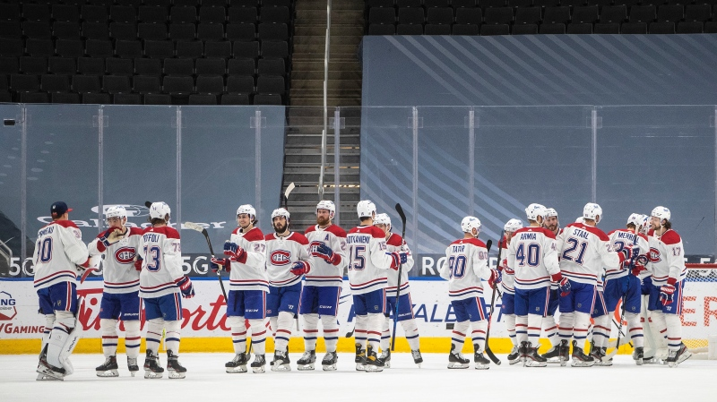 Montreal Canadiens players celebrate the win over the Edmonton Oilers during NHL action in Edmonton on Wednesday, April 21, 2021.THE CANADIAN PRESS/Jason Franson