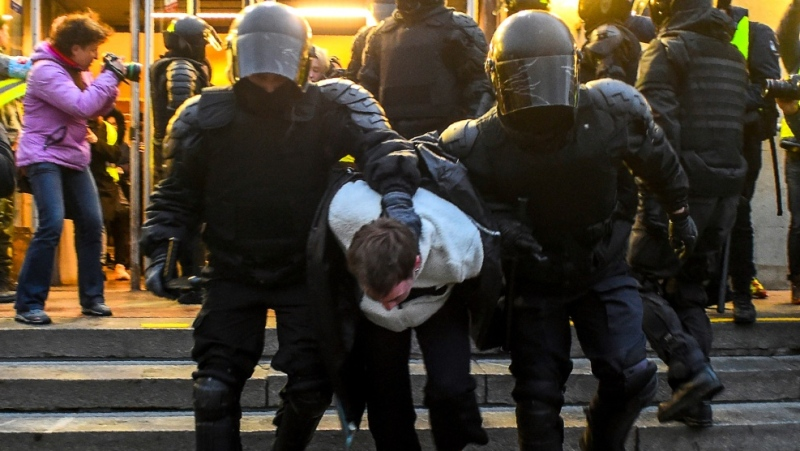 Police officers detain a protester during a rally in support of jailed Kremlin critic Alexei Navalny, in central Saint Petersburg. (AFP)