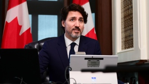Prime Minister Justin Trudeau is joined virtually by Minister of Finance Chrystia Freeland as they talk online to a group of front-line pharmacists from across the country to discuss the ongoing vaccination efforts in the fight against COVID‑19, from the Prime Ministers office on Parliament Hill in Ottawa on Tuesday, April 20, 2021. THE CANADIAN PRESS/Sean Kilpatrick