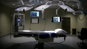 This photo taken on May 19, 2014, shows the new operating room at Sparrow Hospital in Lansing, Mich. Sparrow Health System has more than doubled the size of its surgical center in a $15 million expansion at the hospital. (AP Photo/The State Journal, Al Goldis)