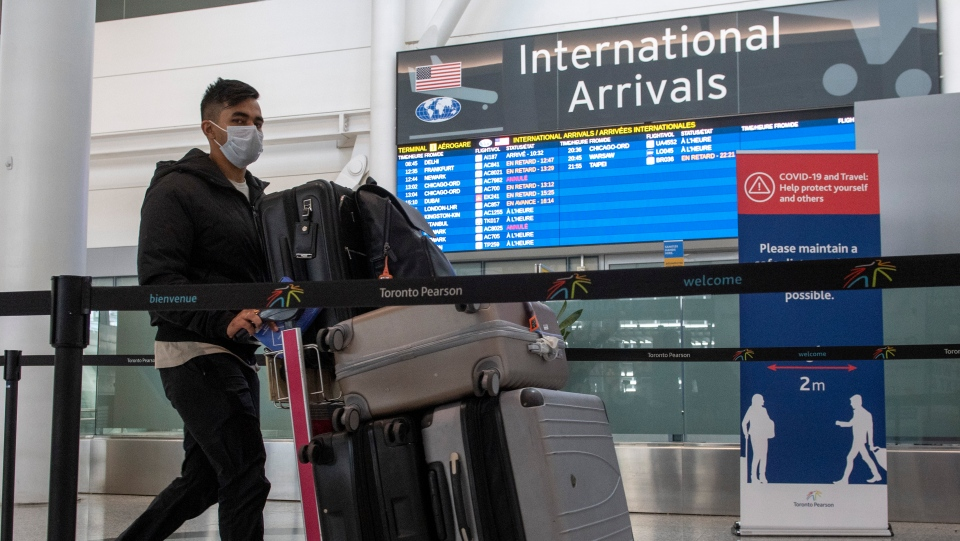 A passenger from Air India flight 187 from New Delhi arrives at Pearson Airport in Toronto on Wednesday April 21, 2021. THE CANADIAN PRESS/Frank Gunn