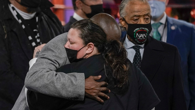 Katie Wright, mother of Daunte Wright gets a hug from attorney Ben Crump during a visitation for Daunte Wright Wednesday, April 21, 2021, in Minneapolis. Daunte Wright was fatally shot by a police officer during a traffic stop. (AP Photo/Morry Gash)