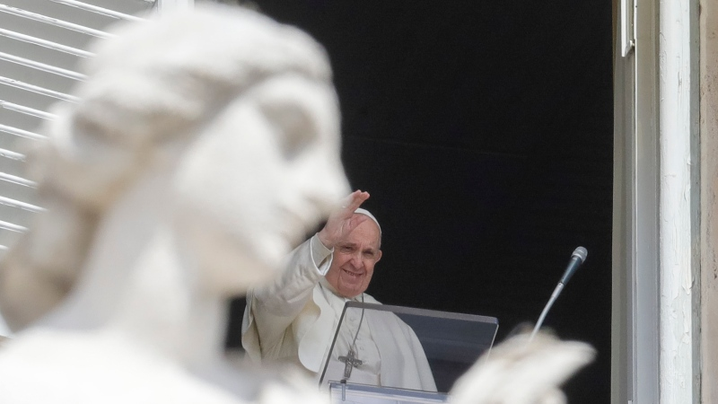 Pope Francis delivers his blessing as he recites the Regina Caeli noon prayer from the window of his studio overlooking St.Peter's Square, at the Vatican, Sunday, April 18, 2021. (AP Photo/Andrew Medichini)