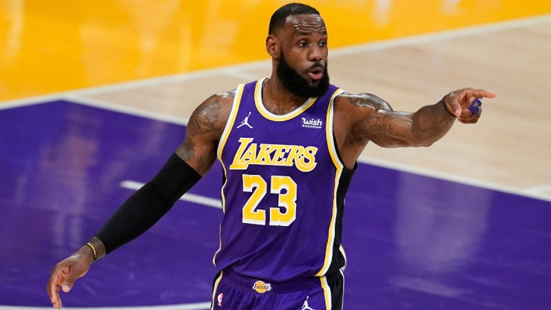Los Angeles Lakers forward LeBron James signals to a teammate during an NBA basketball game against the Charlotte Hornets on March 18, 2021. (Marcio Jose Sanchez / AP)