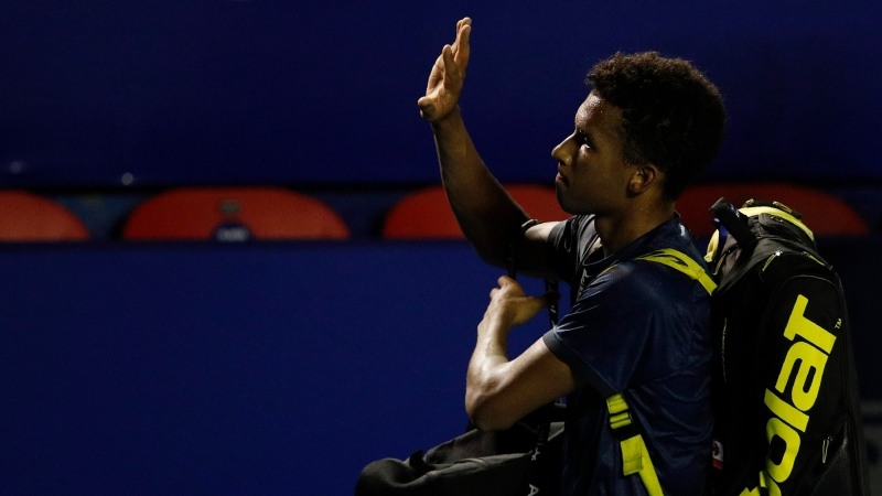 Canada's Felix Auger-Aliassime waves to fans as he walks off the court after losing in a quarterfinal to Greece's Stefanos Tsitsipas at the Mexican Open tennis tournament in Acapulco, Mexico, Thursday, March 18, 2021. (AP Photo/Rebecca Blackwell)
