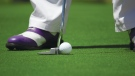 A golfer lines up a putt in this file photo. (Tyler Hendy / Pexels)