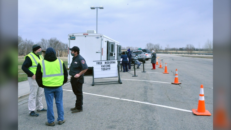 Manitoba truck drivers wait to receive a dose of the COVID-19 vaccine at The Northbound Alexander Henry Rest Area near Drayton, North Dakota. (Image source: North Dakota Department of Transportation)