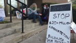 A volunteer nurse tends to Joe Feiner during his hunger strike on the steps of town hall in Alliston, Ont.  Thurs. April 22, 2021 (Roger Klein/CTV News)