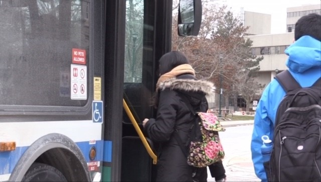 Passengers board a transit bus in London, Ont. on Thursday, April 22, 2021. (Daryl Newcombe / CTV News)