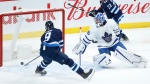 Winnipeg Jets' Andrew Copp (9) scores on Toronto Maple Leafs goaltender Jack Campbell (36) during first period NHL action in Winnipeg on Thursday, April 22, 2021. THE CANADIAN PRESS/John Woods