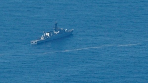 In this aerial photo taken from a maritime patrol aircraft of 800 Air Squadron of the 2nd Air Wing of Naval Aviation Center (PUSPENERBAL), an Indonesian Navy ship sails during a search for the submarine KRI Nanggala that went missing while participating in a training exercise on Wednesday in the waters off Bali Island, Indonesia, Thursday, April 22, 2021. (AP Photo/Eric Ireng)