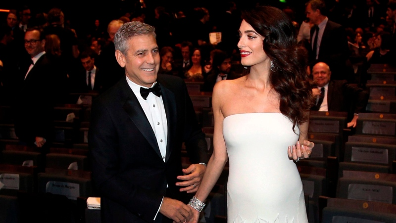 In this Feb. 24, 2017 file photo, actor George Clooney and his wife Amal Clooney arrive at the 42nd Cesar Film Awards ceremony in Paris. (AP Photo/Thibault Camus, File)