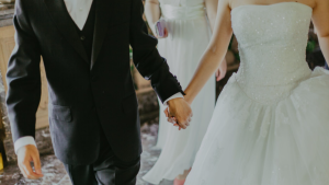 The stock image shows a bride and groom. (Pexels)