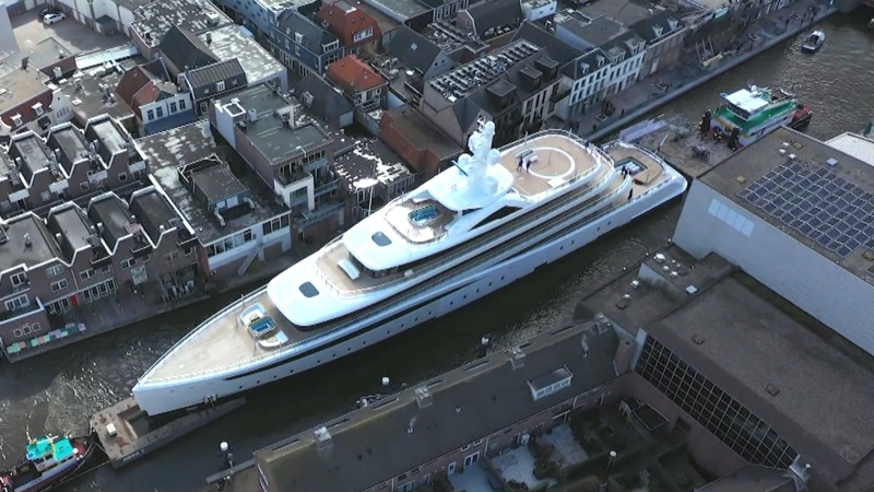 Gigantic super-yacht squeezes through tiny Danish