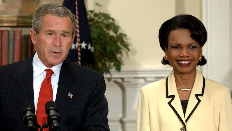 Former U.S. President George W. Bush wrote in the name of his former Secretary of State Condoleezza Rice on his 2020 presidential ballot rather than voting for his own party's nominee Donald Trump for reelection, he told People magazine. They are seen here in 2004. (Ron Sachs/Pool/Getty Images)