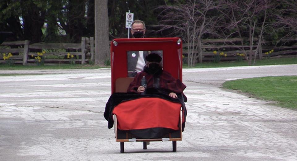 Senior rides in a rickshaw