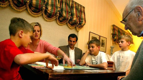 From left, Jack, Kathy, Dave, Max, Alex and Joe Winkler play Monopoly in the family room of their Ridgewood, N.J., home on March 26, 2002. (AP / Jeff Zelevansky)