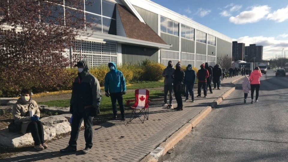 A lineup formed outside the Loblaws at College Square Monday morning to receive the COVID-19 vaccine. (Jim O'Grady/CTV News Ottawa)